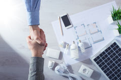 Contractor and customer shaking hands Stock Photos