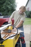 Contractor cutting ceramic tile Royalty Free Stock Photo