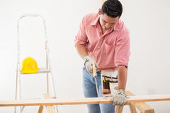Contractor cutting some wood Royalty Free Stock Photography