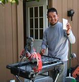 Contractor cutting tiles Royalty Free Stock Photos