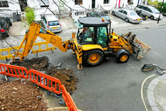 Contractor digging street Stock Images