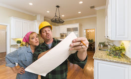 Contractor Discussing Plans with Woman Inside Custom Kitchen Int Royalty Free Stock Photography