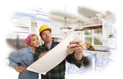 Contractor Discussing Plans with Woman, Kitchen Drawing Photo Be royalty free stock image