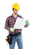 Contractor Examines Blueprint. On the white background. Isolated on white Royalty Free Stock Images