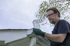 Contractor Examing Down Spout Filter Before Installation Stock Images