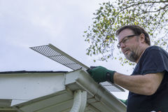 Contractor Examining Plastic Leaf Guard Before Installation Royalty Free Stock Image