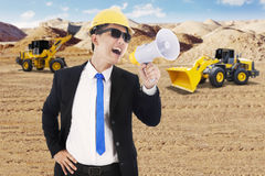 Contractor with excavator and backhoe Royalty Free Stock Image