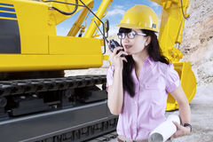 Contractor with excavator in construction site Stock Image