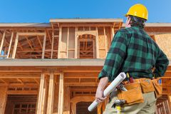 Free Contractor Facing New House Wood Framing At Construction Site Stock Photo - 154123160