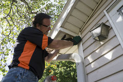 Contractor Fixing Vinyl Siding For Customer Stock Photo