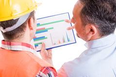 Contractor and foreman checking financial charts Royalty Free Stock Photo