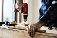 Contractor handyman working and using screwdriver Royalty Free Stock Images