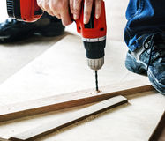 Contractor handyman working and using screwdriver Royalty Free Stock Photos