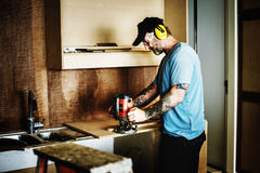 Contractor handyman working and using screwdriver Royalty Free Stock Photography