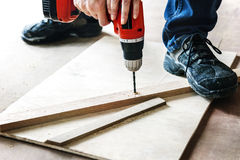 Contractor handyman working and using screwdriver Stock Images