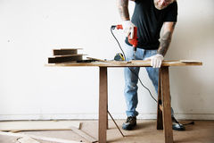 Contractor handyman working and using screwdriver Stock Photo