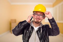 Contractor in Hard Hat on Cell Phone In House Royalty Free Stock Photography