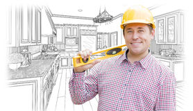 Contractor in Hard Hat with Level Over Custom Kitchen Drawing Royalty Free Stock Image
