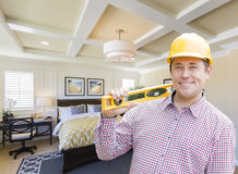 Contractor in Hard Hat Over Custom Bedroom Drawing and Photo Stock Photo