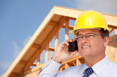 Contractor in Hardhat at Construction Site Stock Photo
