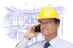 Contractor in Hardhat on Phone Over Custom Kitchen Drawing Royalty Free Stock Images