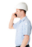 Contractor in hardhat talks on his cell phone. Stock Image