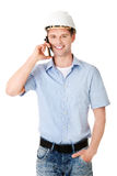 Contractor in hardhat talks on his cell phone. Stock Photo