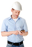 Contractor in hardhat using his cell phone Stock Photo
