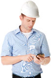 Contractor in hardhat using his cell phone Royalty Free Stock Photos