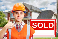 Contractor and home for sale Stock Photo