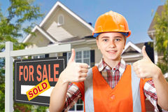 Contractor and home for sale Royalty Free Stock Photos
