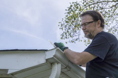 Contractor Installing Plastic Gutter Guards Royalty Free Stock Images