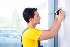 The contractor installing surveillance cctv cameras in office royalty free stock images