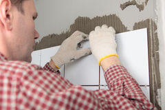Contractor installing tiles Stock Photos