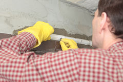 Contractor installing tiles Stock Photo