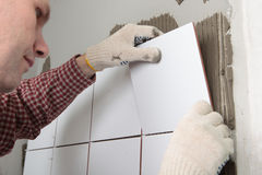 Contractor installing tiles Stock Image