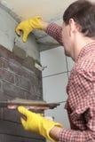 Contractor Installing Tiles Stock Photo