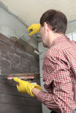 Contractor Installing Tiles Stock Images