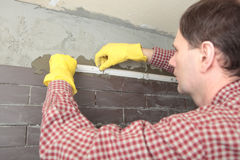 Contractor Installing Tiles Royalty Free Stock Photos