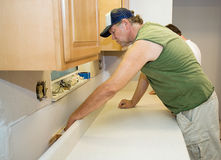 Contractor Installs Laminate Counter Stock Images