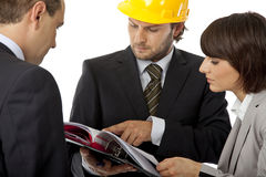 Contractor and investor meeting. Contractor and investors are discussing over plans, isolated Royalty Free Stock Images