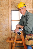 Contractor Leaning on Ladder Royalty Free Stock Photos