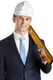 Contractor with level Stock Photo