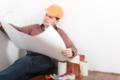Contractor looking blueprints stock images