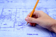 Contractor Marking Blueprints Stock Photo
