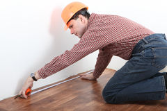 Contractor measuring room Royalty Free Stock Image