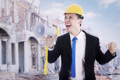 Contractor with megaphone at construction site Stock Photos