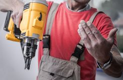Contractor with Nail Gun royalty free stock photo