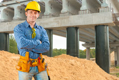 Contractor near the bridge under construction Stock Photo