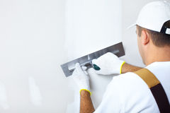 Contractor plasterer. Mature contractor  plasterer working indoors Royalty Free Stock Image